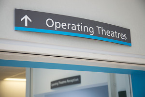 Unique ID: NHS_UCLH_DAY 1 SIGNAGE_0002 Caption: Hospital interior. Information sign above a door. Direction to operating theatres, OR. Restrictions: Copyright: ©