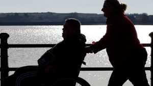 A person being taken out by a carer