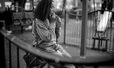 Picture of a young woman smoking in a park