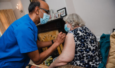 Dr Patel gives Elaine her vaccination