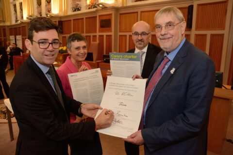 Lord Peter Smith signing Greater Manchester Carers Charter