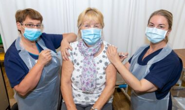 Patient receiving flu and Covid booster vaccines